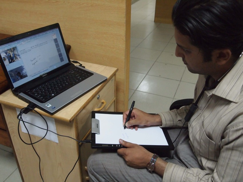 A doctor demonstrating the use of a digital notepad - Photo by: Bilal Farooq