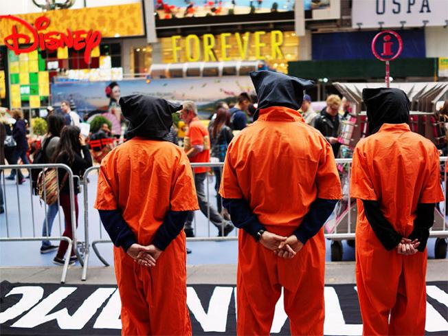 Activists in Times Square, dressed in orange prison jumpsuits, participate in a nationwide 'Day of Action to Close Guantanamo & End Indefinite Detention' on April 11, 2013 in New York City. Source: The Economic Times