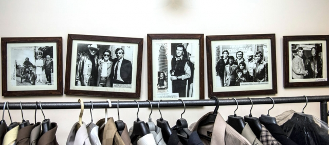 "Framed photographs lining the walls of Chaudry's home testify to his years spent dressing VIPs like Roger Moore (in ""Octopussy,"" center photo).  Photo by: Saad Sarfraz Sheikh"