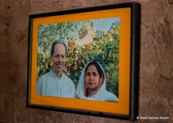 A picture of Roshni founders, Shahida Perveen and her husband Hamid Hannesen, hangs in the main office.