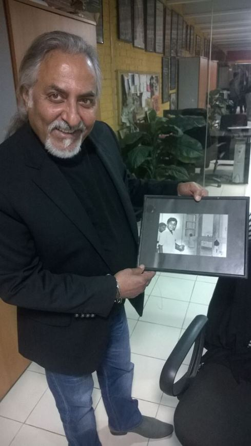 Sadaan Peerzada showing me a framed photo of him and his brother as children