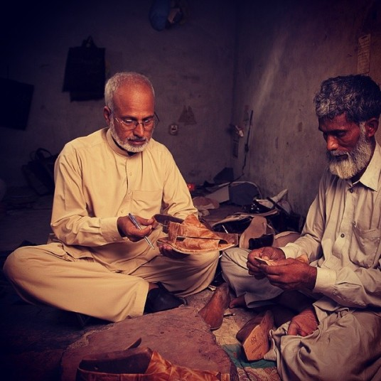 Hussain (left) with his craftsman. Photo: Markhor