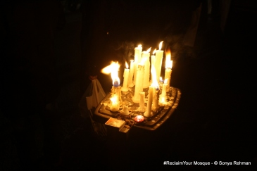 Lit candles at the Liberty Chow, Lahore, protest.