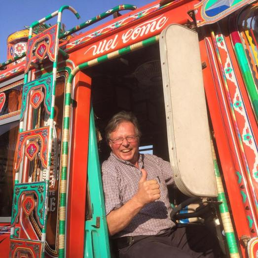 """""""I am a taxi driver back home in Norway, but it's been my lifelong dream to sit in the driver's seat of a typical Pakistani bus and get a photograph taken there. I am very, very happy today. I feel like a kid inside a candy store right now."""" Image Credit: SSE"""