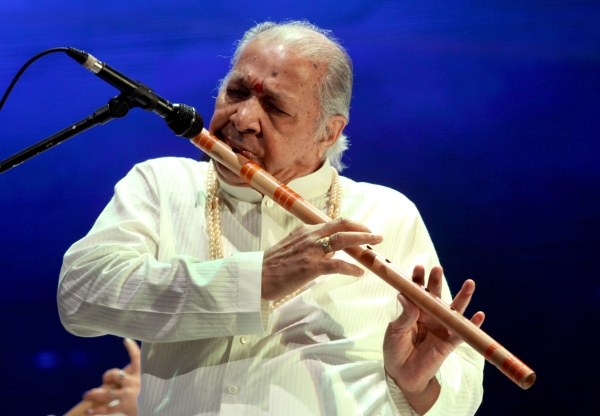 Indian classical flautist Pandit Hariprasad Chaurasia performs during the Art and Artistes 'Panchtatva' musical extravaganza titled 'Concert' by producer Durga Jasraj in Mumbai on December 20, 2014. AFP PHOTO (Photo credit should read STR/AFP/Getty Images)
