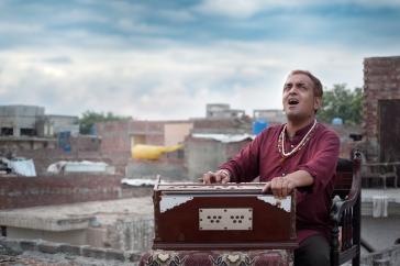 Musician Nijat Ali plays the harmonium - Photo: Nadir Siddiqui