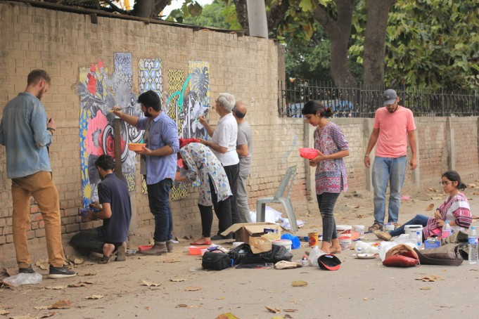 Painting a mural of peace at Gulshan-e-Iqbal Park in Lahore. Photo by Maham Iqbal Boson