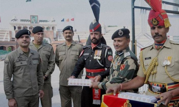 Representatives from Pakistan Rangers Punjab presented sweets to their counterparts from the Indian Border Security Force at the Wagah Border crossing. Photo via DAWN.