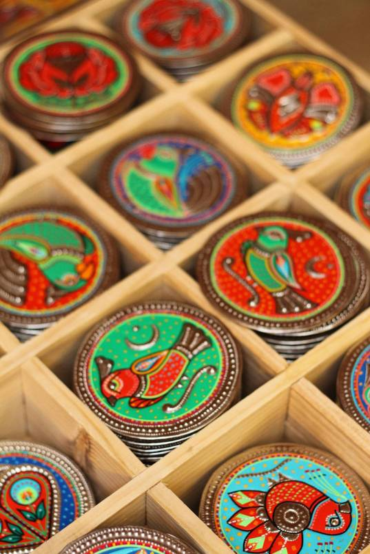 Truck art coasters at the Daachi Exhibition. Photo courtesy of the Daachi Foundation.