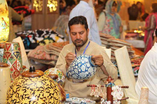 A local artisan with his products at the Daachi Exhibition. Photo courtesy of the Daachi Foundation.