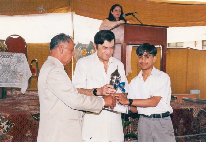 Receiving an award during his school years